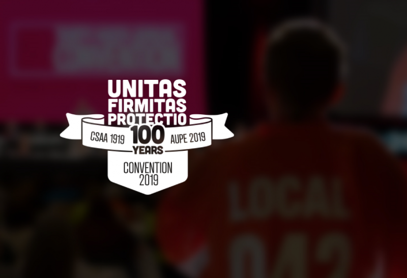 The 2019 Annual AUPE Convention logo which which includes a coat of arms featuring CSAA 1919 and AUPE 2019, noting the 100 year anniversary of the Union as well as the Latin words unitas firmitas protectio.