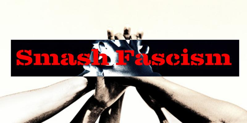 "Many hands are held together into a single first, with superimposed text that reads ""Smash Fascism"""