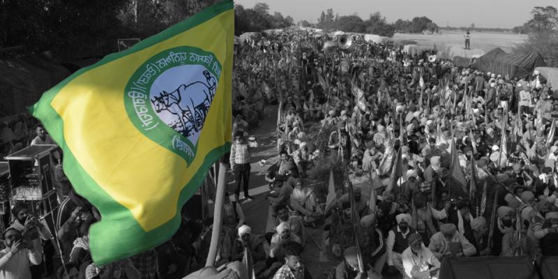 A flag of the Kisaans, or farmers, waves over a crowd of protesting farmers in India